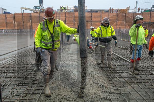 Ian Malsbury oeprates the nozzle as his crew pours a 1,700-yard foundation slab at Saltwood North. (Josh Kulla/DJC)