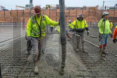 Ian Malsbury oeprates the nozzle as his crew pours a 1,700-yard foundation slab at Saltwood North. (Josh Kulla/DJC)