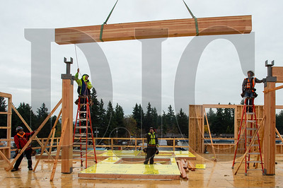 Timberland Inc. carpenters fly a glulam beam into place on the third floor of Building A at Rockwood Rising. (Josh Kulla/DJC)