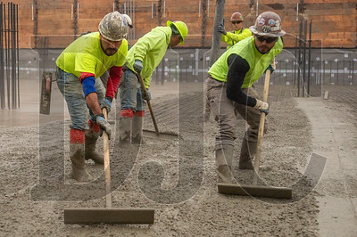 A crew of cement masons with Local 555 and LaRusso Concrete perform finish work. (Josh Kulla/DJC)