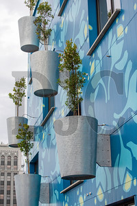 Guerrilla Development's Tree Farm office project in the Central Eastside features tree planters attached to the building's exterior. (Josh Kulla/DJC)