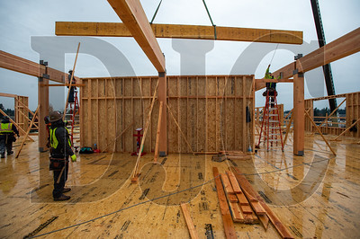 Timberland Inc. carpenters frame the third floor of Building A at Rockwood Rising. (Josh Kulla/DJC)