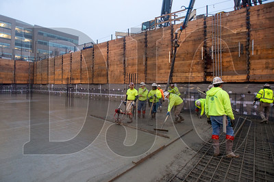 Crews with Bremik Construction and LaRusso Concrete carry out the first of two 1,700-cubic-yard foundation slab pours at Saltwood North. (Josh Kulla/DJC)