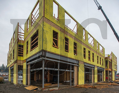 Construction is under way on the first of three buildings at the Rockwood Rising site in Gresham. (Josh Kulla/DJC)
