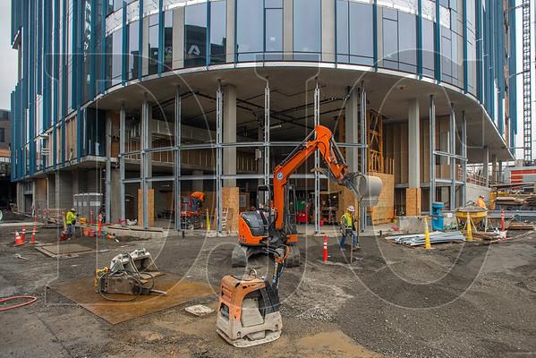 Coffman Excavating crews perform site work for new sidewalks in front of the planned restaurant space. (Josh Kulla/DJC)