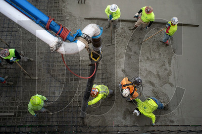 A crew of cement masons with Local 555 and LaRusso Concrete pour the foundation slab at Saltwood North. (Josh Kulla/DJC)