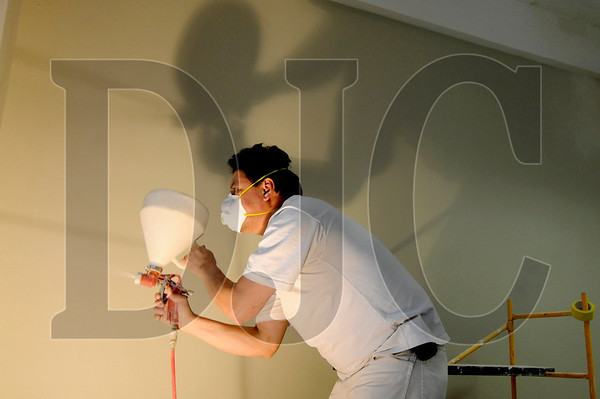 Alfredo Ramirez, a taper with Skyline Interiors and member of Local 10, sprays texture onto a wall at Broadway Commons, formerly known as the Commerce Building, in downtown Portland Jan. 20.