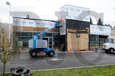 A former Chrysler dealership in Southwest Portland has been converted to a MINI dealership by R&H Construction. The LRS Architects-designed renovation includes a completely remodeled showroom, new rack system and mezzanine in the parts department, offices, a steel canopy for vehicle delivery, and updated lighting to meet Energy Trust specifications. The dealership is slated to open today.