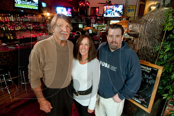 """East Bank Saloon owners Robert """"Pudgy"""" Hunt, left, and his wife, Connie, along with sons Kevin, right, and David (not pictured)  restored the Southeast Portland sports bar and restaurant after a September 2011 grease fire caused major damage."""