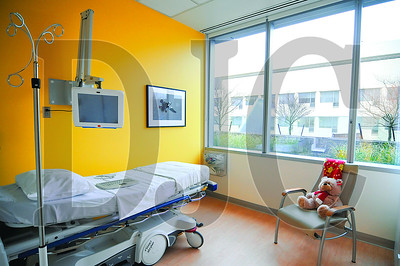 A chemotherapy treatment room at Randall Children's Hospital at Legacy Emanuel features visual themes that appear throughout the hospital, including bright colors, animal graphics, and large windows providing bright natural light.
