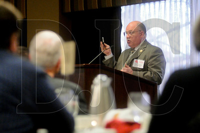 Clark County Sheriff Garry Lucas holds up a smartphone while speaking about the importance of technology and social media in catching thieves during the Construction Industry Crime Prevention awards luncheon at the Multnomah Athletic Club Feb. 15.