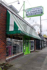 A 9,500-square-foot lot at 1424 E. Burnside St. is for sale at a recently-lowered listing price of $689,000. A building on the property, which has entrances on both East Burnside Street and Southeast Ankeny Street, currently houses a flower shop and an apartment. The lot's zoning allows for a four-to-five story tall, 48-unit, mixed use apartment.