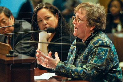 Debbie Kitchin, right, of contracting firm Interworks LLC, speaks before Portland City Council against proposed legislation requiring mandatory earned sick leave for workers in the city.Also pictured are business owners, from left, David Louie of Huber's Restaurant and Lisa Watson of Cupcake Jones, both of whom also opposed the ordinance.