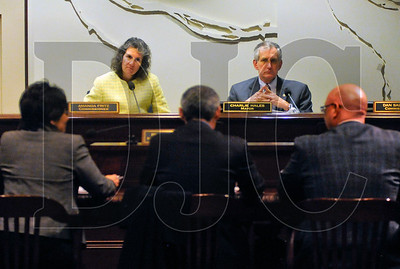 Portland City Commissioner Amanda Fritz, top left, and Mayor Charlie Hales, top right, listen as Portland Business Alliance representative Bernie Bottomly, bottom center, speaks against a proposed ordinance requiring employers to provide workers with earned sick pay.