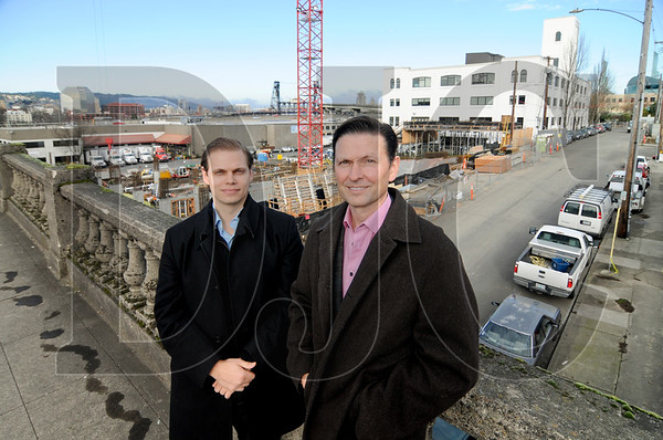 Adrian Boly, left, and Tom Brenneke of Guardian Real Estate Services stand in front of B67, a 21-story tower the firm is co-developing with Key Development.