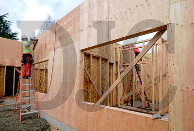 Carpenters with Timberland Framing Contractors frame a first-floor unit.