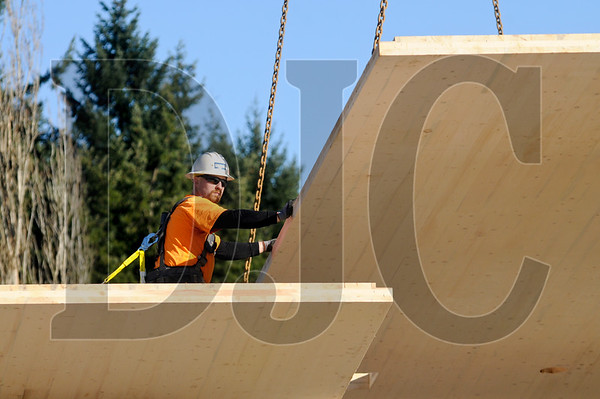 Crews with Lease Crutcher Lewis installed a roof made of cross-laminated timber Tuesday on a new building at the Oregon Zoo, marking the first use of the material in the state. A total of seven panels, measuring about eight feet wide and with a thickness of 5 ½ inches, were lifted into place atop a visitor center under construction as part of the zoo's new Elephant Lands exhibit.