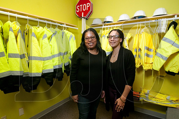 Reynelda Hayes, left, Carmen Cammon are the respective owner and office manager of All About Flagging, which Hayes founded in 2014. (Sam Tenney/DJC)