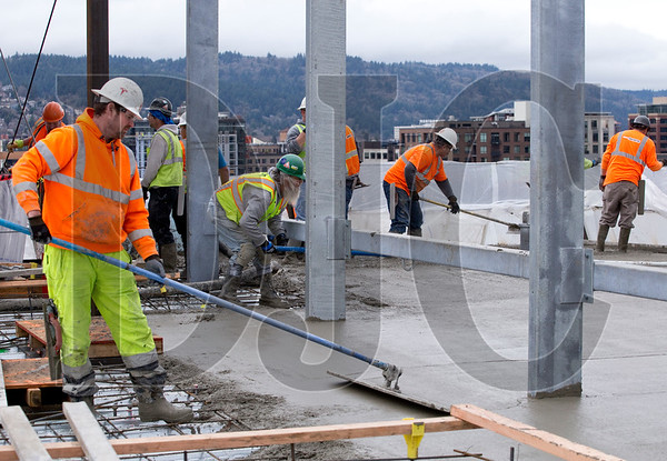 Crews finish concrete on level 10 of the building.