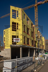The wedge-shaped building is being erected on a triangular lot overlooking Interstate 405. (Josh Kulla/DJC)