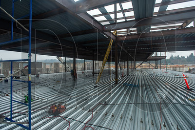Installation of pan decking is under way on the third floor of the four-story classroom building. (Josh Kulla/DJC)