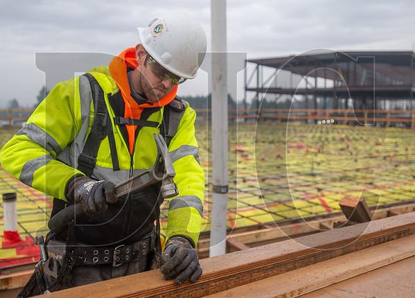 Jeff Nevin, an apprentice carpenter with Local 1503 and an employee of Skanska USA Building, constructs formwork at the new Sherwood High School. (Josh Kulla/DJC)