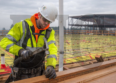 Jeff Nevin, an apprentice carpenter with Local 1503 and an employee of Skanska USA Building, constructs formwork at the new Sherwood High School. (Josh Kulla/DJC)