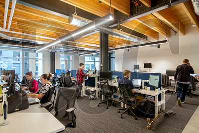 Vacasa employees work in the firm's 60,000-square-foot office in the Heartline building last fall.  (Sam Tenney/DJC)
