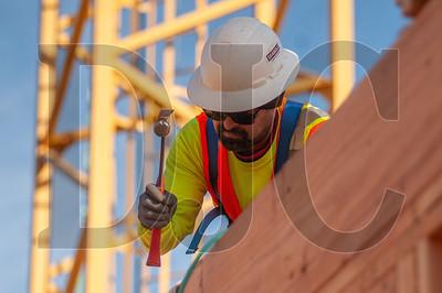 Journeyman carpenter Mario Davalos, an employee of Advanced Pro Builders, frames walls on the building's fourth floor. (Josh Kulla/DJC)