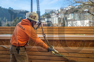 Tyson Wenz, a journeyman crane rigger with Seabold Construction, secures a load of floor joists. (Josh Kulla/DJC)