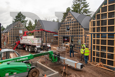 The Going Street Commons development in Northeast Portland will include 11 zero-energy-ready residential units in eight buildings. (Josh Kulla/DJC)