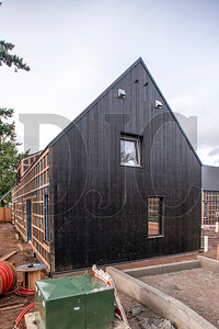 The buildings are being clad in black-stained Larch wood siding. (Josh Kulla/DJC)