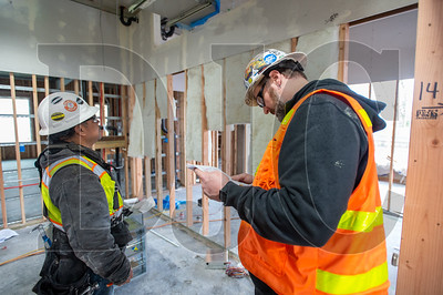 Walsh Construction Co. Project Manager Scott Rascoe (right) took an untraditional route into management, first learning a skilled trade and gaining experience before returning to college for a two-year construction management degree. (Josh Kulla/DJC)