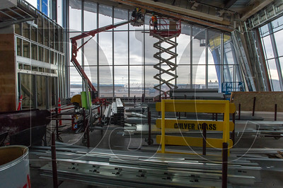 Carpenters from Performance Contracting Inc. frame the ceiling at the east end of the new concourse. (Josh Kulla/DJC)