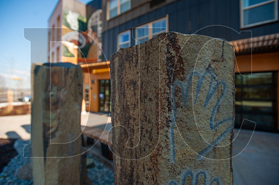 The huge basalt columns comprising the courtyard sculpture installation  by Lillian Pitts are all inlaid with custom art pieces of their own. (Josh Kulla/DJC)