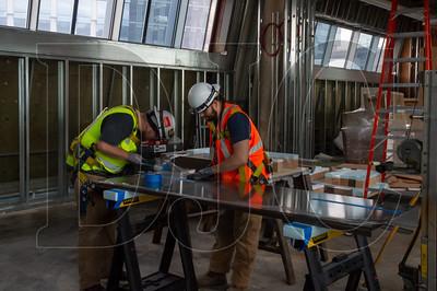 Apprentice Dustin Schmeer (left) and journeyman Troy Brigham, both sheet metal technicians with Local 16 and employees of Hanset Sheet Metal, fabricate ductwork. (Josh Kulla/DJC)