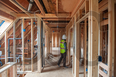Stephen Aiguier walks through a home at Going Street Commons. (Josh Kulla/DJC)