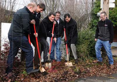 Project team members break ground at the site of the Milano, a 60-unit apartment project, in Northeast Portland Jan. 27.