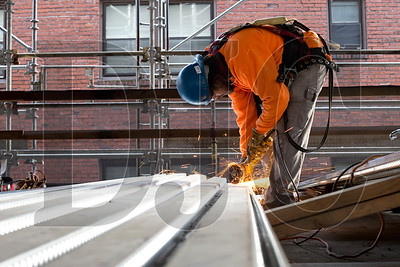 Alan Humbard, an ironworker with Northwest Structural Services, cuts a notch in pan decking.