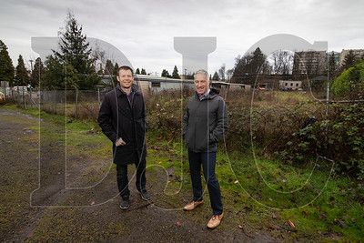 Developer Noel Johnson, left, of Cairn Pacific, and architect Rick Potestio of Potestio Studio stand at the site of an upcoming 14-unit single-family subdivision the pair are working to bring to a property on Northwest Wilson Street. (Sam Tenney/DJC)
