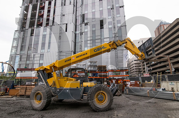 Lori Dehaven operates a telescopic handler equipped with a clean diesel engine at the Multnomah County Central Courthouse project. (Sam Tenney/DJC)