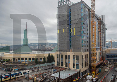 The Hyatt Regency Portland at the Oregon Convention Center was topped out two months ago and will be under construction through the end of the year. (Josh Kulla/DJC)