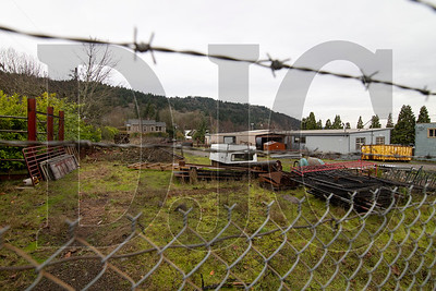 A 14-lot subdivision with East Coast-style row houses is planned for an undeveloped parcel with R1 zoning in Northwest Portland. (Sam Tenney/DJC)