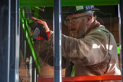 Eddie Casley, a member of Local 146 and an ISE carpenter with Western Partitions Inc. measures steel framing on the Five Oaks Middle School job site. (Josh Kulla/DJC)