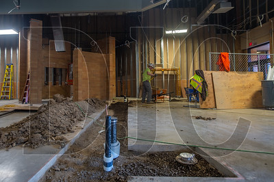 Plumbers are installing new drainage lines in the administrative area of Five Oaks Middle School. (Josh Kulla/DJC)