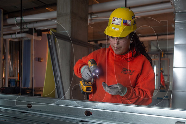 Selena Canales, an exterior and interior speciality carpenter with Local 146 and an employee of Performance Contracting, Inc., works on cold-formed metal framing. (Josh Kulla/DJC)