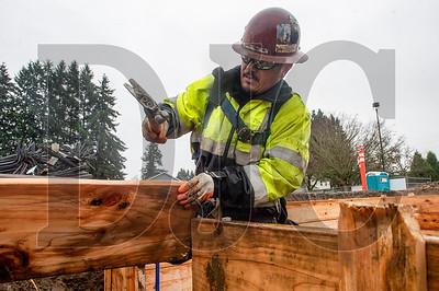 Journeyman carpenter Carlos Martinez, a member of Local 1503 and an employee of Zavala Corporation, constructs formwork for foundation footings. (Josh Kulla/DJC)