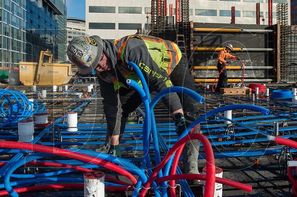 Apprentice plumber Ben Dolato, a member of Local 290 and an employee of Ocean Park Mechanical, installs in-slab water lines. (Josh Kulla/DJC)