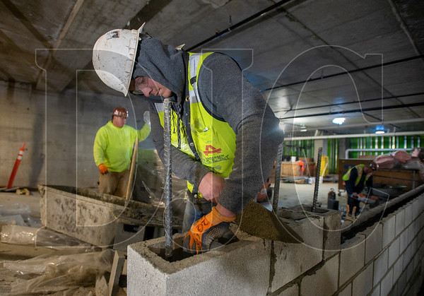 Niko Jensen, a journeyman cement mason with Local 1 and a foreman with J&S Masonry, lays CMU blocks. (Josh Kulla/DJC)