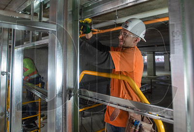 Apprentice carpenter Mark Waldo of Local 146 and Western Partitions Inc. frames an interior wall. (Josh Kulla/DJC)